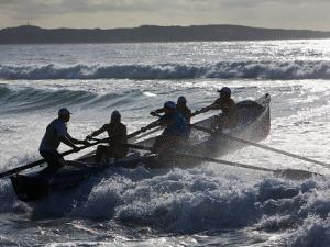 New South Wales, A Surfboat Crew Battles Through Waves at Cronulla Beach in Sydney, Australia by Andrew Watson
