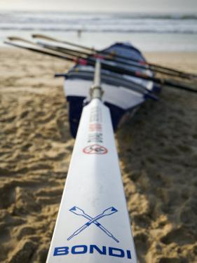 New South Wales, Sydney, A Surfboat Sits on Beach at Bondi in Sydney's Eastern Beaches, Australia by Andrew Watson