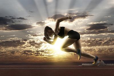 Woman Sprinter Leaving Starting Blocks by Andrey Burmakin