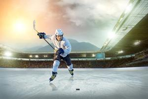 Ice Hockey Player on the Ice. Open Stadium - Winter Classic Game. by Andrey Yurlov