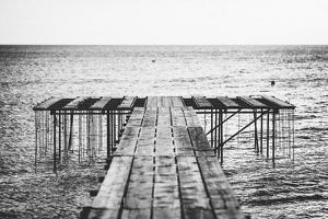 A Dock Leads Toward the Ocean by Andy Bardon
