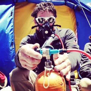 An Everest Expedition Member Uses Oxygen for Safety by Andy Bardon