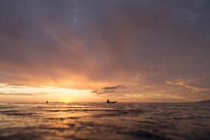 Canoes Off Tahiti Island at Sunset by Andy Bardon