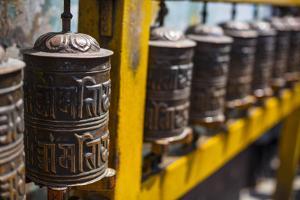 Prayer Wheels at Boudhnath Temple by Andy Bardon