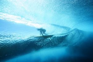 Underwater View of a Surfer with a Surfboard by Andy Bardon