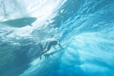 Underwater View of Surfers with Surfboards by Andy Bardon