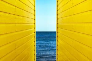 2 Yellow Beach Huts by Andy Bell