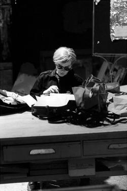 Andy at Typewriter, The Factory, NYC, circa 1965 by Andy Warhol/ Nat Finkelstein