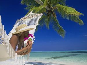 Woman Lying in a Hammock, Maldives Island by Angelo Cavalli