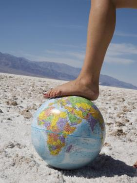 Woman's Foot on Globe, Bad Waters Point, Death Valley National Park, California, USA by Angelo Cavalli