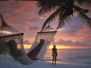 Women on Beach, Ari Atoll, White Sands Island by Angelo Cavalli