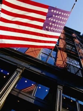 American Flag Waving at West Broadway in Soho, New York City, New York, USA by Angus Oborn