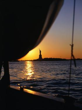 Statue of Liberty at Sunset from Staten Island Ferry, New York City, New York, USA by Angus Oborn