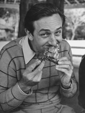 Animator and Movie Producer Walt Disney Eating Chicken
