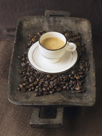 A Cup of Espresso on a Wooden Bowl with Coffee Beans