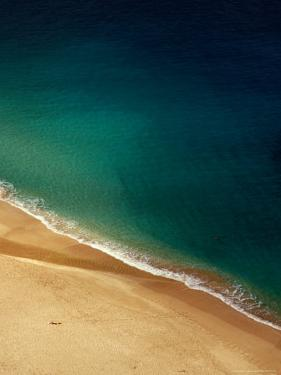 A Lone Sunbather Stretches Out on the Sand, Waimea, Oahu, Hawaii, USA by Ann Cecil