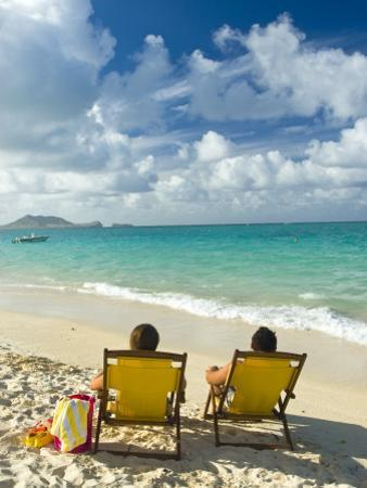 Couple Relaxing on Beach at Lanikai on Windward Side of Oahu by Ann Cecil