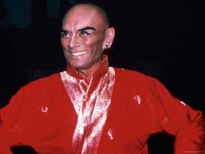 """Actor Yul Brynner in Costume and Makeup for Role in Broadway Revival of Musical """"The King and I"""" by Ann Clifford"""
