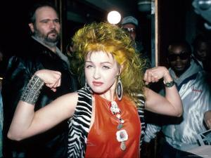 Singer Cyndi Lauper Flexing Her Muscles by Ann Clifford