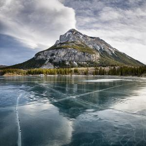 Canada, Alberta, Bow Valley Provincial Park. Frozen Barrier Lake and Mount Baldy by Ann Collins