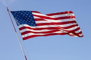 USA, California, San Diego. American flag waves above Liberty Station by Ann Collins