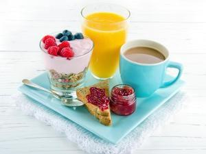 Breakfast With Yoghurt, Berries, Juice, Toast And Coffee by Anna-Mari West