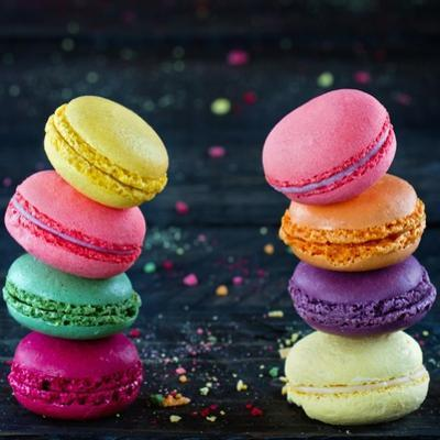 Two Piles Of Colorful Macaroons by Anna-Mari West