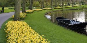 Boat on Keukenhof Gardens Lake in Early Spring by Anna Miller