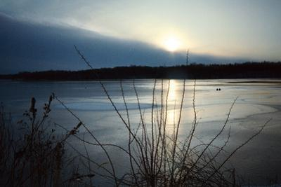 Frozen lake sunset, Eagle Creek Park, Indianapolis, Indiana, USA by Anna Miller