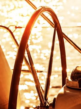 Image of Sailboat Helm on Sunset, Steering Wheel of Yacht, Rudder of Vessel on Sunrise, Sea Transpo by Anna Omelchenko
