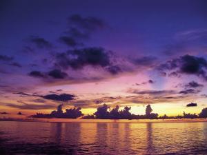 Sunset in the Cayman Islands by Anne Flinn Powell