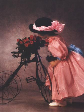 Justine Smelling Roses on Bike by Anne Geddes