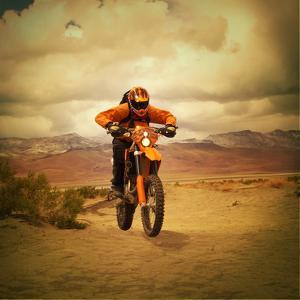 Man Riding Motocross Bike by Anne-Marie Weber