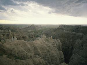 A Storm Moves over Sheep Mountain Table in Badlands National Park by Annie Griffiths Belt