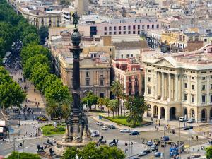Barcelona with Tree-Lined Las Ramblas Avenue and Statue of Colon by Annie Griffiths Belt