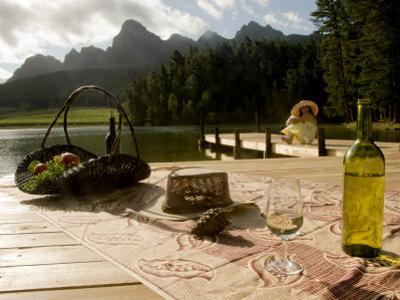 Glass of Wine and an Open Bottle in South Africa's Wine Country by Annie Griffiths Belt