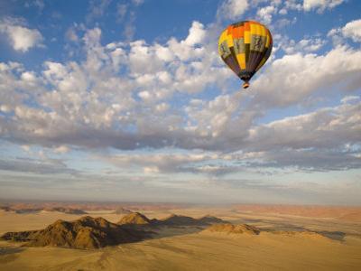 Hot Air Balloon in Flight over the Namib Desert by Annie Griffiths Belt