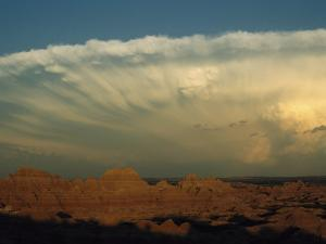 Storm Moves across the Badlands at Cedar Pass by Annie Griffiths Belt