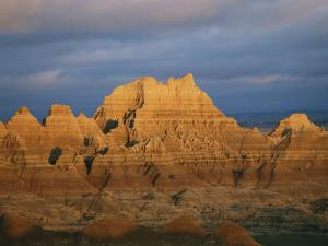 Sunset on the Claystone Buttes of the Badlands Near Cedar Pass by Annie Griffiths Belt