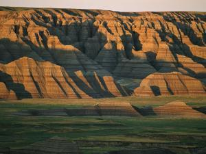 Sunset on the Eroded Land Formations of the Badlands by Annie Griffiths Belt
