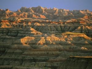 Sunset on the Geological Formations of the Badlands by Annie Griffiths Belt