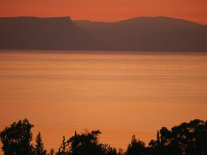 Sunset Paints the Sea of Galilee Orange by Annie Griffiths Belt