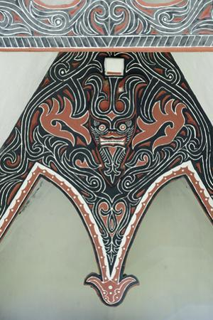 Detail of Traditional Batak Tribal Painted Carving with Stylised Buffalo Horns