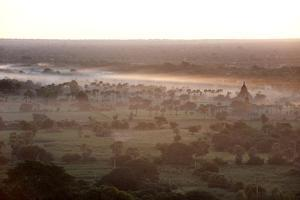 Mists from the Nearby Irrawaddy River Floating across Bagan (Pagan), Myanmar (Burma) by Annie Owen