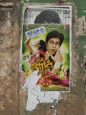 Shahruk Khan in Torn Bollywood Movie Poster on Wall, Hospet, Karnataka, India, Asia by Annie Owen