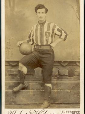Anonymous Footballer in Kit with Football