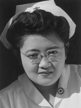 Catherine Natsuko Yamaguchi, Red Cross instructor, Manzanar Relocation Center, 1943 by Ansel Adams