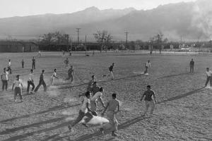Football game at Manzanar Relocation Center, 1943 by Ansel Adams