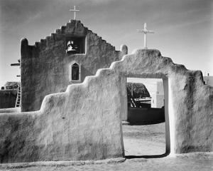 Full side view of entrance with gate to the right, Church, Taos Pueblo National Historic Landmark,  by Ansel Adams