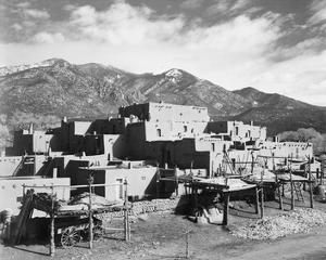 Full view of city, mountains in background, Taos Pueblo National Historic Landmark, New Mexico, 194 by Ansel Adams